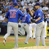 CHICAGO - JUNE 21:  Aramis Ramirez #16 is congratulated by pitcher Matt Garza #17 of the Chicago Cubs after Ramirez made a nice defensive play against the Chicago White Sox on June 21, 2011 at U.S. Cellular Field in Chicago, Illinois.  (Photo by Ron Vesely)  Subject:  Aramis Ramirez;Matt Garza