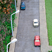 row of parked cars on street in Maduradam Model Village