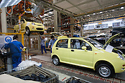 Factory workers build QQ cars on the assembly line in the Chery Automobile factory in Wuhu, China, May 16, 2007. Chery Automobile Co Ltd, one of China's fastest-growing carmakers, plans to export 10,000 cars and 10,000 sets of components this year. The Anhui Province-based firm said in a statement Thursday that if the goal is reached, it will be a very great achievement because China exported a total of 2,849 cars last year..More than 600 cars from Chery's five low-end models will be sent to the Middle East and South America this month, including Syria and Kuwait.