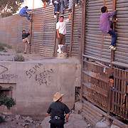 Undocumented migrants gather along the U.S.-Mexico border in San Diego, California. Please contact Todd Bigelow directly with your licensing requests. <br /> <br /> Photo registered with the US Copyright Office. © Todd Bigelow<br /> <br /> Please contact Todd Bigelow directly with your licensing requests. <br /> <br /> PLEASE CONTACT TODD BIGELOW DIRECTLY WITH YOUR LICENSING REQUEST. THANK YOU!