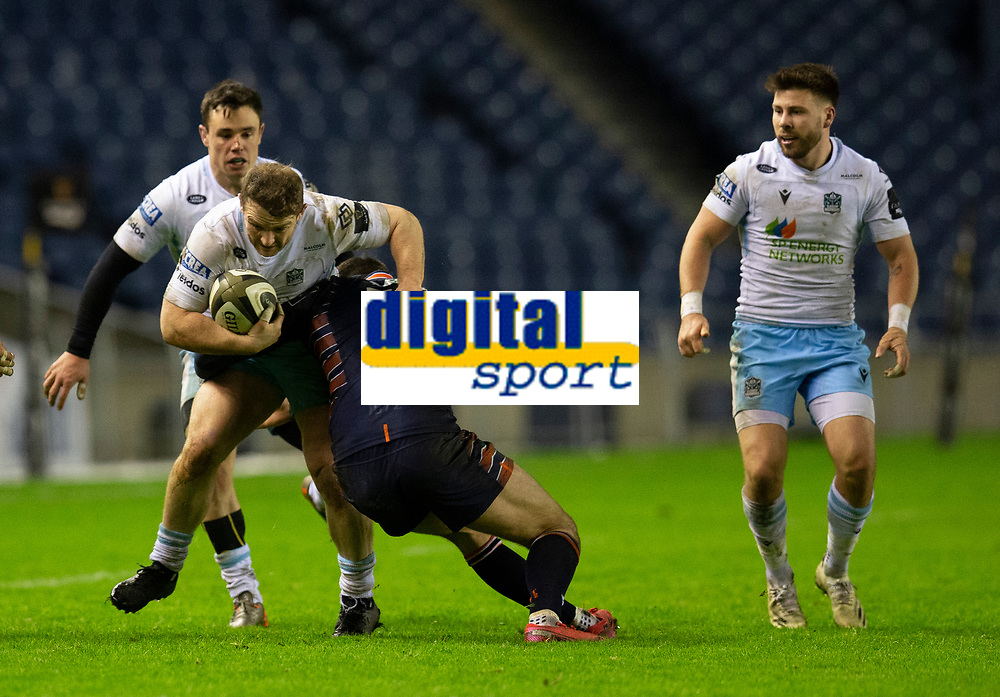 Rugby Union - 2020 / 2021 Guinness Pro-14 - Edinburgh vs Glasgow Warriors - Murrayfield<br /> <br /> Nick Grigg of Glasgow Warriors is tackled by Blair Kinghorn of Edinburgh Rugby<br /> <br /> COLORSPORT/BRUCE WHITE
