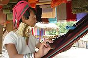 Padaung Karen woman weaving with traditional handloom Chiang Mai Province, Thailand