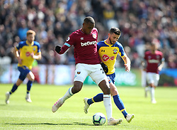 West Ham United's Issa Diop and Southampton's Shane Long during the Premier League match at the London Stadium.