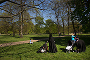 Muslim women wearing burkhas in Kensington Gardens. In a selected few boroughs of West London, wealth has changed over the last couple of decades. Traditionally wealthy parts of town, have developed into new affluent playgrounds of the super rich. With influxes of foreign money in particular from the Middle-East. The UK capital is home to more multimillionaires than any other city in the world according to recent figures. Boasting a staggering 4,224 'ultra-high net worth' residents - people with a net worth of more than $30million, or £19.2million.. London, England, UK.