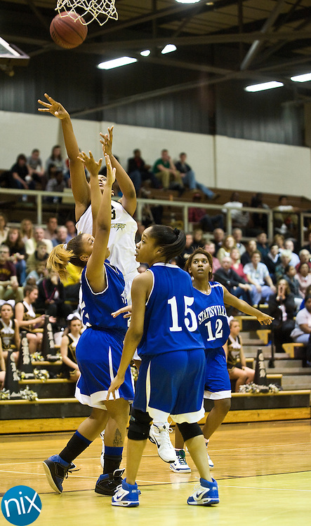 Concord's Jatzmin Johnson takes a shot against Statesville Wednesday night at Concord High School during the second round of the state playoffs. The Lady Spiders won 68-49 to advance. (Photo by James Nix | jnix@independenttribune.com)