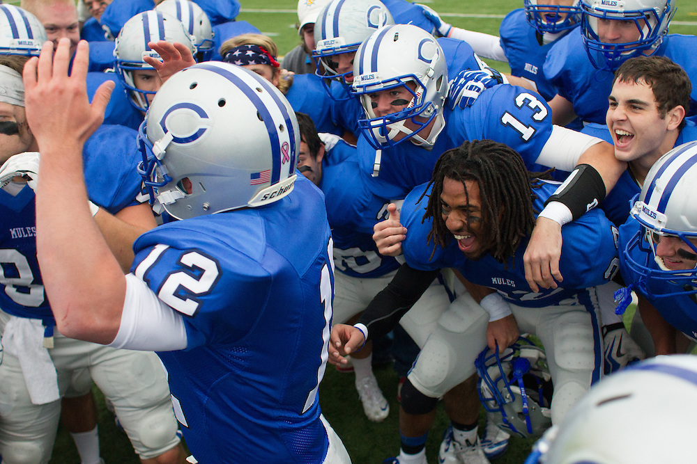 Colby College football celebrates after an NCAA Division III football game against Bates College on October 26, 2013 in Waterville, ME. (Dustin Satloff/Colby College Athletics)