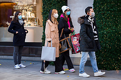 © Licensed to London News Pictures. 05/12/2020. LONDON, UK.  Shoppers queue to enter Selfridges department store in Oxford Street on the first Saturday after lockdown restrictions were lifted on 2 December.  Retailers are hoping that physical sales will pick up in the run up to Christmas.  This comes against a backdrop of two major retailers Debenhams and Arcadia, owner of Topshop, collapsing into administration in the last week.  Photo credit: Stephen Chung/LNP