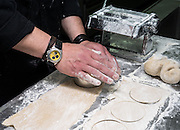 Making Tortellini pasta cutting to size