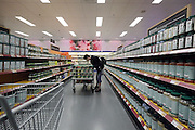 wholesale supermarket aisle with a person shopping