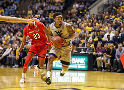 Feb 26, 2018; Morgantown, WV, USA; West Virginia Mountaineers guard Daxter Miles Jr. (4) drives down the lane during the second half against the Texas Tech Red Raiders at WVU Coliseum. Mandatory Credit: Ben Queen-USA TODAY Sports