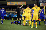 Sutton United Roarie Deacon (21) yellow card during the The FA Cup third round replay match between AFC Wimbledon and Sutton United at the Cherry Red Records Stadium, Kingston, England on 17 January 2017. Photo by Matthew Redman.