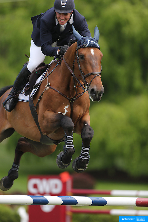 Quentin Judge riding HH Quatuor  in action during the $35,000 Grand Prix of North Salem presented by Karina Brez Jewelry during the Old Salem Farm Spring Horse Show, North Salem, New York, USA. 15th May 2015. Photo Tim Clayton