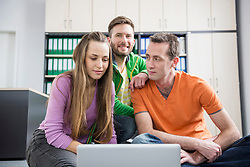 Three young work colleagues woman men planning