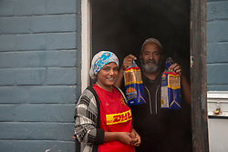 """A family is happy to receive bread delivered by volunteered to the community of Parkwood, a subburb of Cape Town, located on the Cape Flats, Monday, April 20, 2020. The majority of the people who live here are unemployed during """"normal"""" circumstances. And as South Africa is now in lockdown due to the Coronavirus, many of those who had jobs have also lost their income. So many people are starving. The feeding scheme is a joint community effort, paid for solely by donations from the public to feed more than 3,000 households. The group is also receiving transportation support by The South African Red Cross Society. PHOTO: EVA-LOTTA JANSSON"""