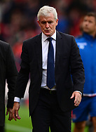 Mark Hughes, the manager of Stoke city leaves the pitch at half time. Premier league match, Stoke City v Arsenal at the Bet365 Stadium in Stoke on Trent, Staffs on Saturday 19th August 2017.<br /> pic by Bradley Collyer, Andrew Orchard sports photography.