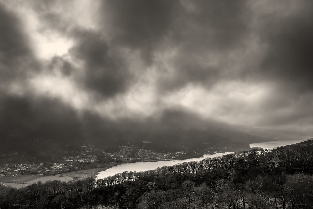It was strange to be standing in sunshine one one side of the valley, looking towards the banks of fog rolling over the hillsides opposite. The bustling town of Llanberis looked so tiny below the crazy swirling weather above.<br /> <br /> UNESCO World Heritage Site
