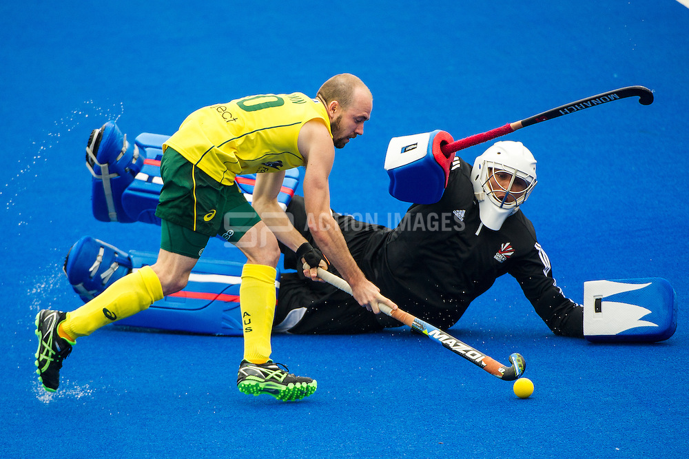 Australia's Matthew Swann takes on George Pinner of Great Britain. Great Britain v Australia, Lee Valley Hockey & Tennis Centre, London, UK on 13 June 2015. Photo: Simon Parker