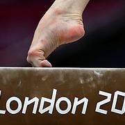 A study of gymnasts feet on the balance beam.