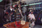 Virtual reality in undersea exploration: bench testing of an undersea tele-robotic robot arm, being developed for the U.S. Navy by the Centre for Engineering Design at the University of Utah, Salt Lake City. The functions of this robot are the performance of complex underwater tasks by remote manipulation from the surface. Underwater video cameras & other imaging systems relay information to a computer that produces a 3-D virtual image of the seabed. The operator is linked to this world through a headset equipped with 3-D goggles, & spatial sensor, and data gloves or other clothing that relay precision movements back through the computer to tools on the robot's limbs. (1990)