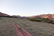 Mountain bikers on the bike and walking trail in the South Valley Park Ken-Caryl Ranch Open Space in Colorado at dawn. WATERMARKS WILL NOT APPEAR ON PRINTS OR LICENSED IMAGES.