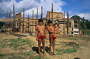 YANOMAMI INDIANS. South America, Brazil, Amazon. Yanomami with university development. Yanomami indians, a primitive tribe, living in the tropical rainforest, in communal traditional molaca dwellings. They are huntergatherers passing on their traditions and skills  from generation to generation. They are the guardians of their forest and its fragile ecosystem. Their lifestyle and their lands diminish every year in the face of encroaching deforestation, forest fires, campesinos who slash and burn primary rainforest, from cattle ranching, commercial plantations, gold and diamond mines.