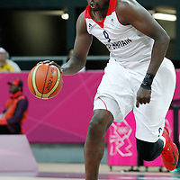 31 July 2012: Great Britain Luol Deng brings the ball upcourt during 67-62 Team Brazil victory over Team Great Britain, during the men's basketball preliminary, at the Basketball Arena, in London, Great Britain.
