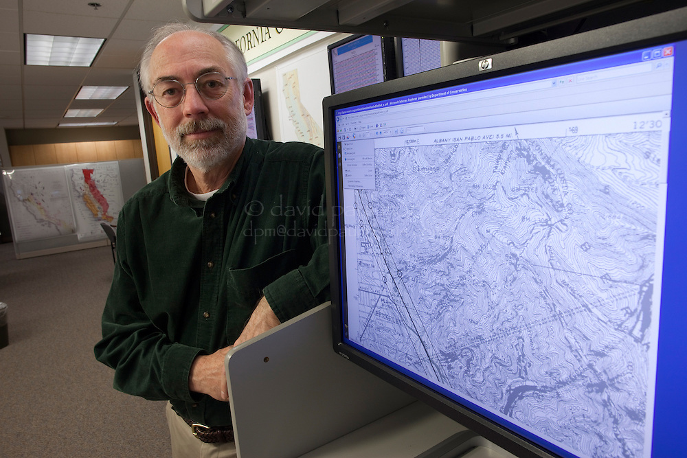 Bill Bryant, Senior Engineering Geologist for the California Geological Survey shows off the Alquist-Priolo earthquake Fault Zone Maps that are now available online at the California Geological Survey office on February 10, 2011 in Sacramento, California.  Photography by David Paul Morris/Special to the California Report