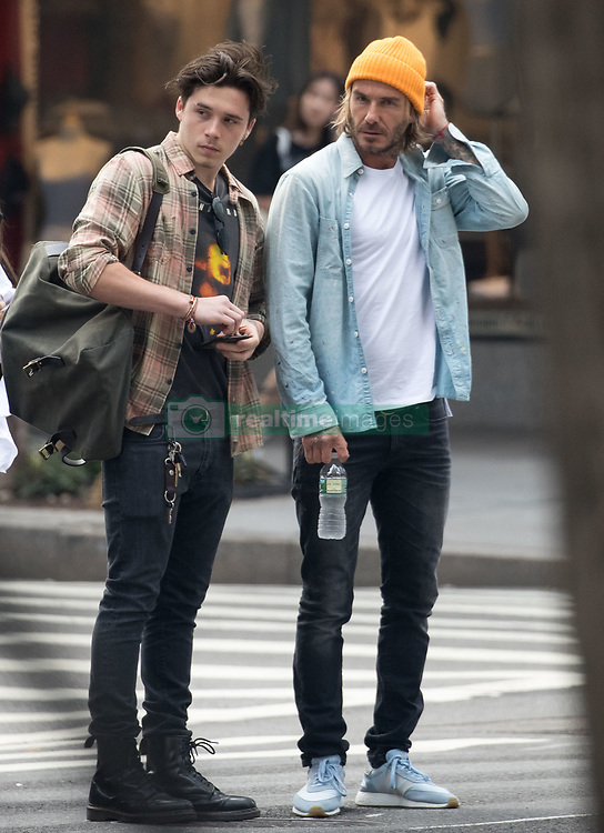 EXCLUSIVE: Brooklyn Beckham, who will be studying photography at Parsons School of Design in New York City this fall, took his dad, David Beckham along to Orientation Day. The father-son duo visited two buildings on the downtown campus and even though it was in the 80's (23 degrees Celsius) David Beckham insisted on wearing a wool hat. Brooklyn was channeling the 90's by rocking a flannel longsleeve over a Soundgarden T-shirt. 22 Aug 2017 Pictured: Brooklyn Beckham, David Beckham. Photo credit: MEGA TheMegaAgency.com +1 888 505 6342