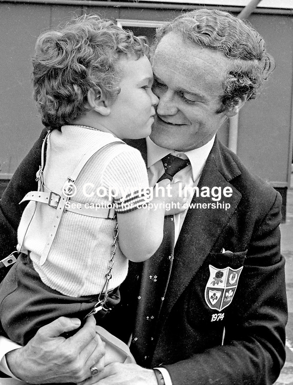 Irish International rugby player, Mike Gibson, re-united with his son, Colin, at Belfast's Aldergrove Airport (later to be renamed Belfast International Airport) on his return from the British and Irish Lions Tour to South Africa. 197407300479b.<br /> <br /> Copyright Image from Victor Patterson, Belfast, UK<br /> <br /> t: +44 28 9066 1296 (from Rep of Ireland 048 9066 1296)<br /> m: +44 7802 353836<br /> e: victorpattersonbelfast@gmail.com<br /> <br /> www.images4media.com<br /> <br /> Please see my full Terms and Conditions of Use at https://www.images4media.com/p/terms-conditions - it is IMPORTANT that you familiarise yourself with them.<br /> <br /> Images used online incur an additional cost. This cost should be agreed in writing in advance. Online images must be visibly watermarked i.e. © Victor Patterson or that of the named photographer within the body of the image. The original metadata must not be deleted from images used online.<br /> <br /> This image is only available for the use of the download recipient i.e. television station, newspaper, magazine, book publisher, etc, and must not be passed on to a third party. It is also downloaded on condition that each and every usage is notified within 7 days to victorpattersonbelfast@gmail.com.<br /> <br /> The right of Victor Patterson (or the named photographer) to be identified as the author is asserted in accordance with The Copyright Designs And Patents Act (1988). All moral rights are asserted.