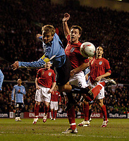 Photo: Jed Wee.<br /> England v Uruguay. International Friendly. 01/03/2006.<br /> <br /> Uruguay's Diego Lugano (L) just diverts the ball from the path of England's John Terry.