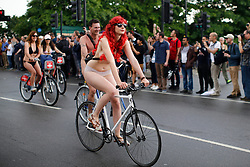 © Licensed to London News Pictures. 11/06/2016. London, UK. Nude protesters take part a naked bike ride in central London on Saturday, 11 June 2016 as part of the World Naked Bike Ride event, which protests against car culture and aims to raise awareness of cyclists on the roads. Photo credit: Tolga Akmen/LNP