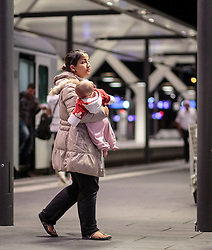 13.09.2015, Hauptbahnhof Salzburg, AUT, Fluechtlinge am Hauptbahnhof Salzburg auf ihrer Reise nach Deutschland, im Bild eine Flüchtlings Mutter mit einem schlafenden Kleinkind // a refugee mother with a sleeping baby. According to reports thousands of refugees fleeing violence and persecution in their own countries continue to make their way toward the EU, just days before Euopean leaders are set to meet in Brussels to discuss a solution to the arrival of so many people, Main Train Station, Salzburg, Austria on 2015/09/13. EXPA Pictures © 2015, PhotoCredit: EXPA/ JFK
