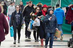©Licensed to London News Pictures 24/12/2019. <br /> Bromley ,UK. Last minute Christmas eve shoppers brave the wind and rain in Bromley High Street, South East London.Photo credit: Grant Falvey/LNP