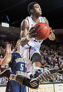 New Mexico State University's Daniel Mullings drives around Northern Colorado player Tevin Svihovec and looks to pass back out from the baseline on Wednesday at the Pan American Center in Las Cruces, N.M. (AP PHOTO/Las Cruces Sun-News, Robin Zielinski)