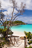 On the island of St. John, one of four U.S. Virgin Islands, exists Virgin Islands National Park. This is Trunk Bay the crown jewel of beaches within the park. Trunk Cay is just offshore.