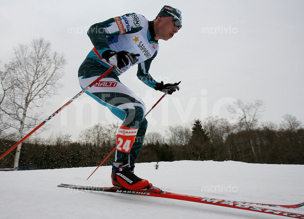 Sapporo , 030307 , Nordische Ski Weltmeisterschaft  Nordische Kombination 15km Langlauf ,  Hannu MANNINEN (FIN)