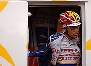Cofidis rider waits for the start of the 2004 edition Liege Bastogne Liege cycle race.