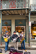 Jazz musicians saxophonist and guitarist live busking performance on street corner in French Quarter of New Orleans, USA