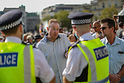 """People argue with police as thousands of protesters from across the UK gathered in London's Trafalgar Square on Saturday, Sept 19, 2020 - afternoon to protest against coronavirus restrictions and reject mass vaccinations. The event, which began at noon, drew a broad coalition including coronavirus sceptics, 5G conspiracy theorists and so-called """"anti-vaxxers"""". Speakers at the event accused the government of attempting to curtail civil liberties. (VXP Photo/ Vudi Xhymshiti)"""