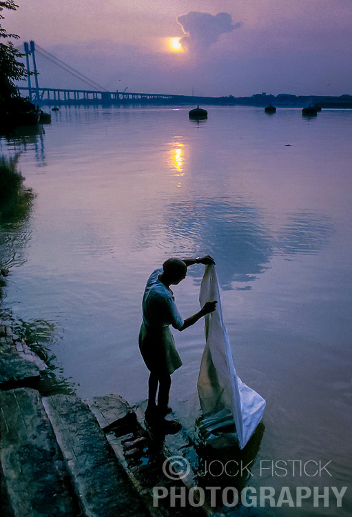 CALCUTTA, INDIA - OCTOBER 1992 - The Hooghly River in Calcutta, India is an intricate part of daily life for city dwellers. It serves as a source for food, transportation, a bathroom and a place to do the family laundry. It is also a source of much disease. (PHOTO © JOCK FISTICK)