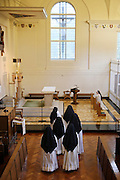 Sisters go to pray at the crypt in the Tyburn Convent on Bayswater Rd, London.