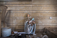 A damaged statue of the Virgin Mary, the head placed back onto the body, leans against a wall inside a church in Qaraqosh, Iraq. A predominately Christian town, Qaraqosh was taken by ISIS in 2014 and then retaken from ISIS in October 2016. (May 5, 2017)