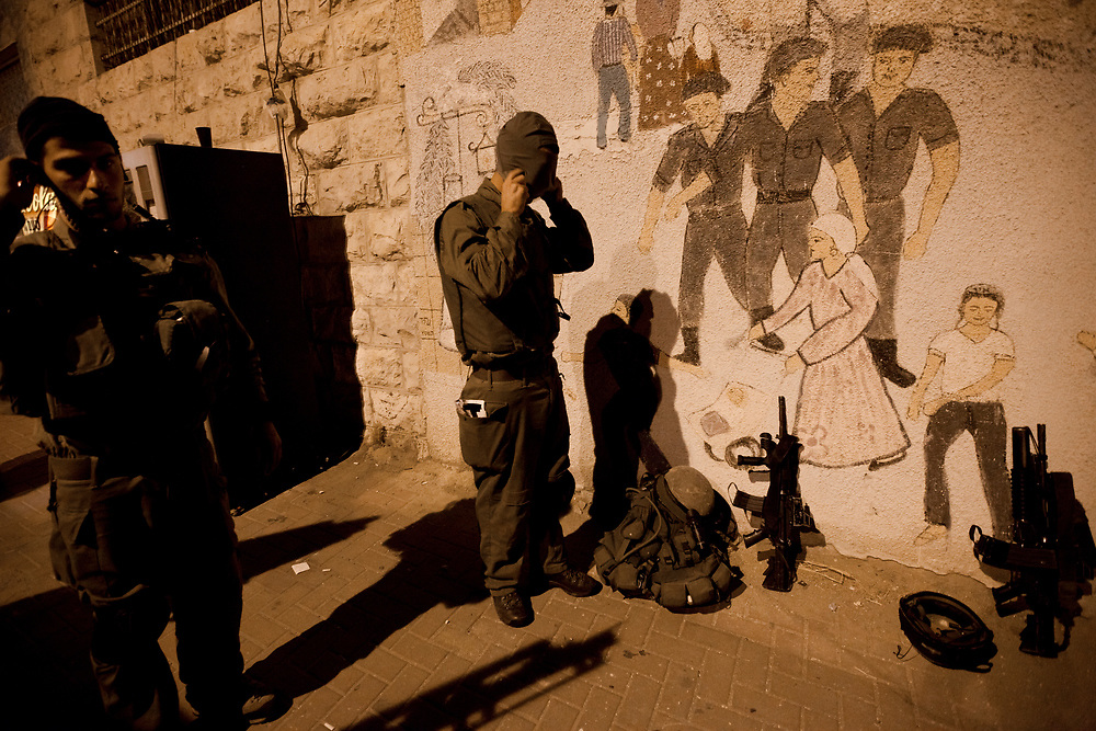 Israeli soldiers of The Paratroopers Brigade reconnaissance unit (Hebrew: 'Palsar Tzanhanim') prepare for a night time military operation in the West Bank city of Hebron, on September 15, 2011.