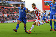 Danny Simpson of Leicester City (l) looks to block Ramadan Sobhi of Stoke City's cross. Premier league match, Stoke City v Leicester City at the Bet365 Stadium in Stoke on Trent, Staffs on Saturday 4th November 2017.<br /> pic by Chris Stading, Andrew Orchard sports photography.