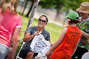 Kristin Armstrong happily signs a t-shirt for volunteer Natalie Ancker of Hayden, right, following the completion of the Blue Cruise outside Woodland Middle School on Saturday.