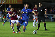 AFC Wimbledon striker James Hanson (18) battles for possession with West Ham United midfielder Robert Snodgrass (11) during the EFL Carabao Cup 2nd round match between AFC Wimbledon and West Ham United at the Cherry Red Records Stadium, Kingston, England on 28 August 2018.