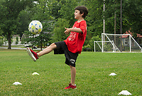 """Caleb """"Rocky"""" Allen works on his one touch drills during On Goal Soccer Camp at Leavitt Park Thursday morning. (Karen Bobotas/for the Laconia Daily Sun)"""