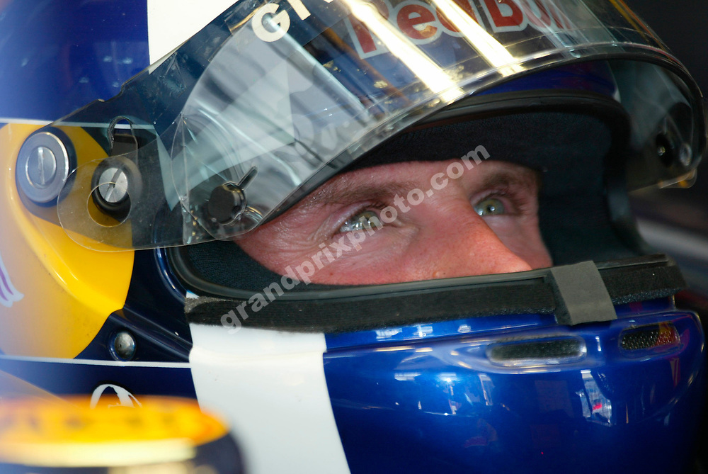 Red Bull-Cosowrth driver David Coulthard with helmet during practice for the 2005 Bahrain Grand Prix. Photo: Grand Prix Photo