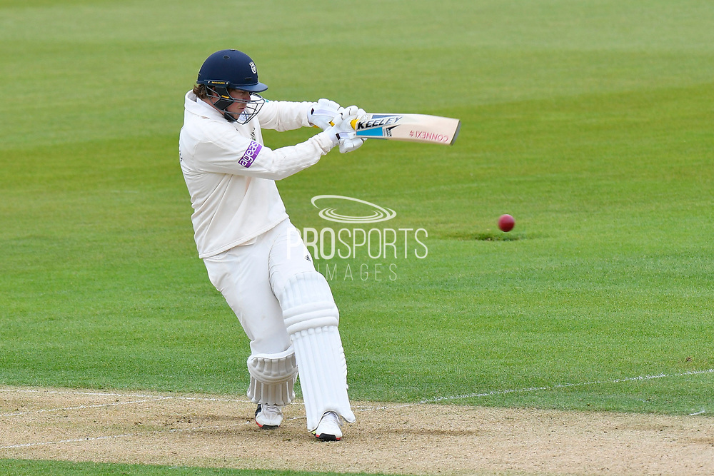 Sam Northeast of Hampshire hits the ball to the boundary for four runs during the first day of the Specsavers County Champ Div 1 match between Hampshire County Cricket Club and Essex County Cricket Club at the Ageas Bowl, Southampton, United Kingdom on 5 April 2019.