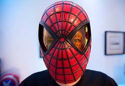 © Licensed to London News Pictures. 19/07/2012. LONDON, UK. A member of staff from toy producer Hasbro wears the new 'Spider-Man Hero FX Mask' at the company's 'Christmas in July' toy launch in London today (19/07/12). The mask, based on the super heros latest look in the upcoming film 'The Amazing Spider Man', features light up eyes and electronic sound effects amd is set to hit the shops for Christmas 2012 priced at GB£24.99. Photo credit: Matt Cetti-Roberts/LNP